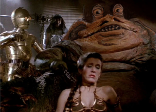 A badly photoshopped picture of jabba the hut with eye stalks and floppy ears.